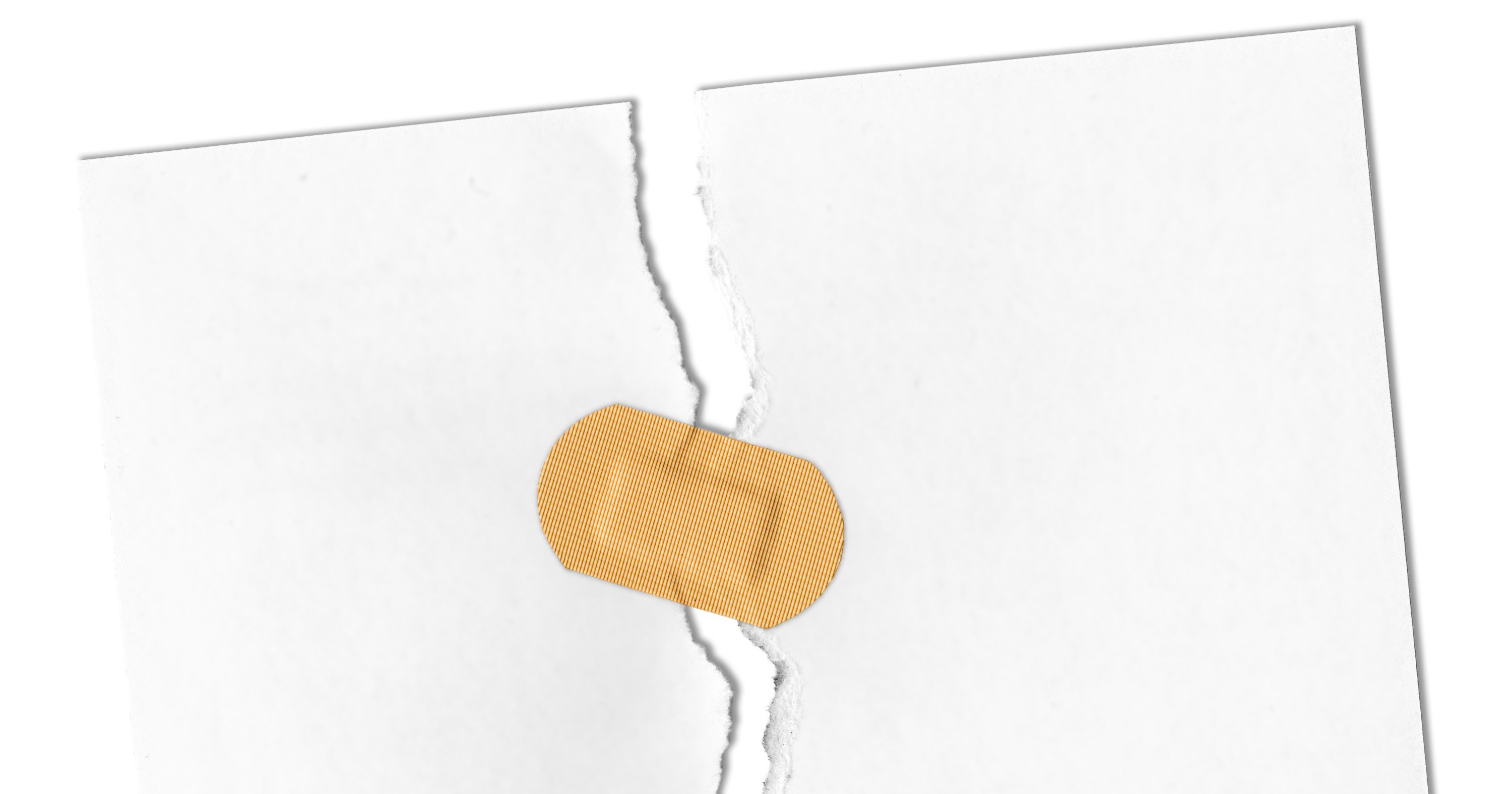 Photo of a plaster holding together a piece of ripped paper