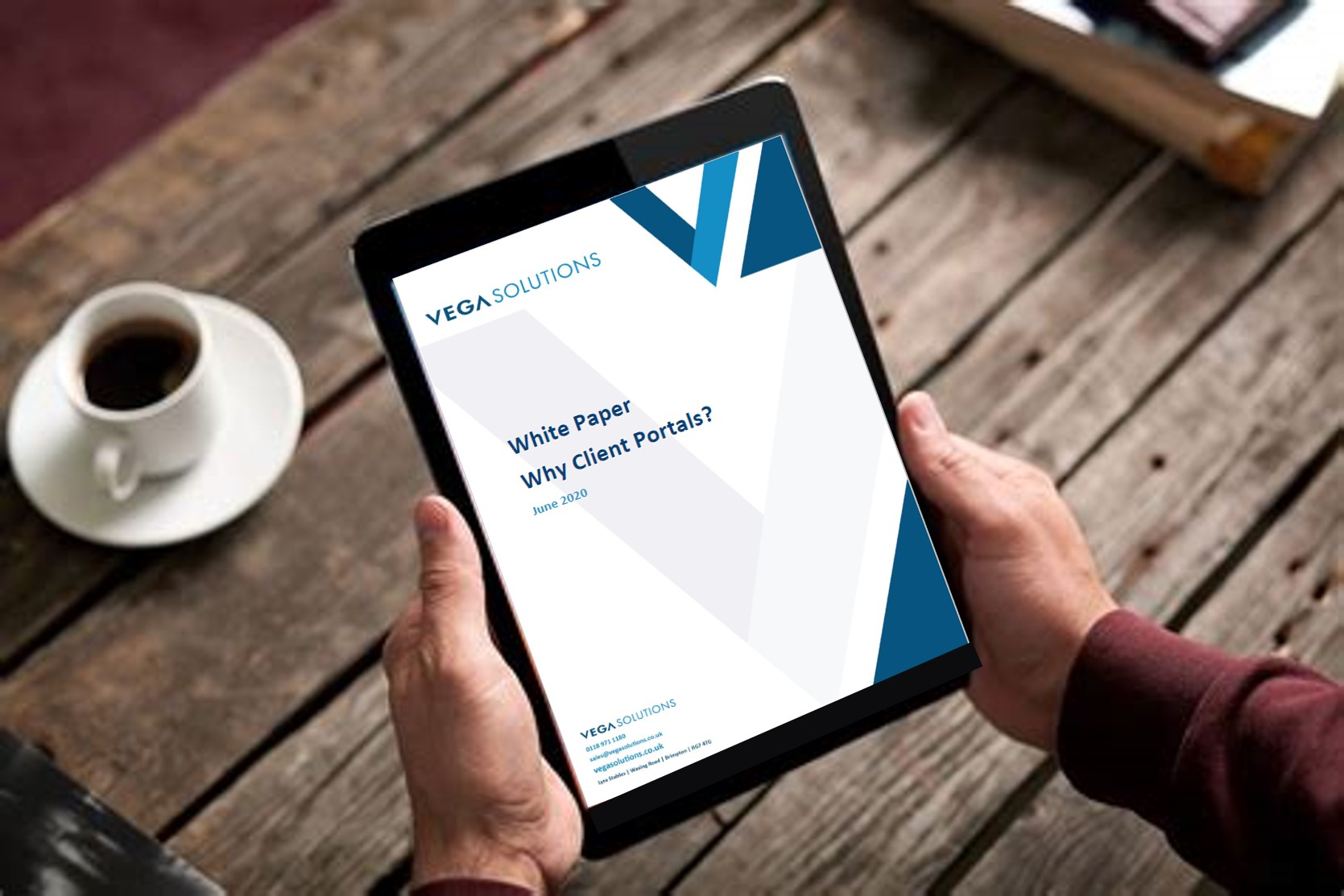 Tablet showing the front cover of Solitaire Consulting white paper